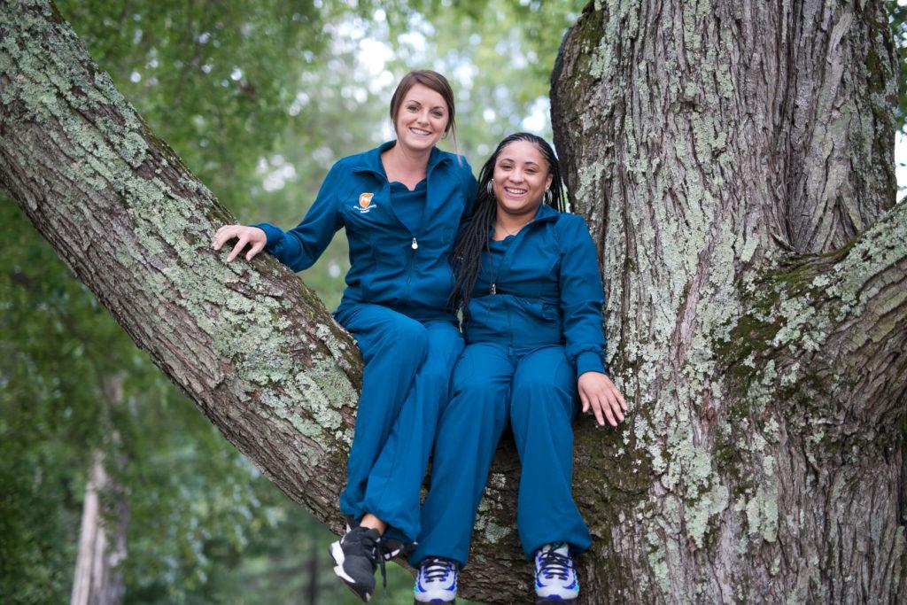 Dental Assistants sitting in a big tree in Greensboro NC