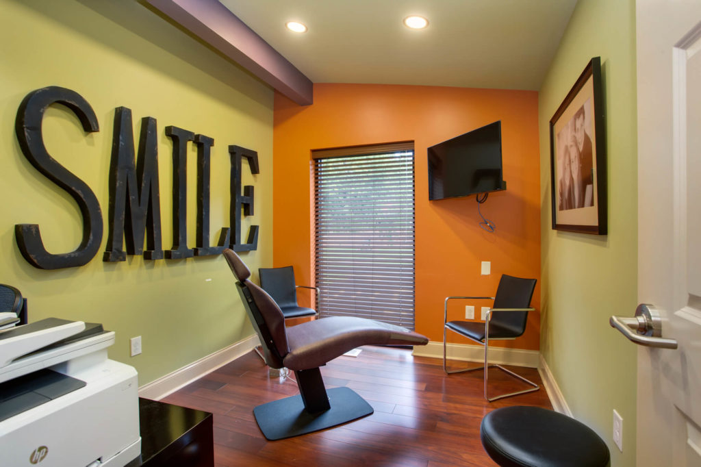 SMILE decorations for dental office on Orange and Green walls