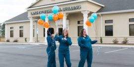 Surgical Assistants holding balloons outside of dental office