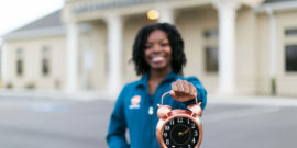 Clock in focus with dental assistant blurred in background
