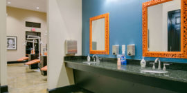 Turquoise and Orange Ortho Bay Sinks and Mirrors at Orthodontist Office