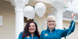 NCOSO Employees smiling with balloons