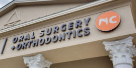 NC Oral Surgery and Orthodontics logo on building