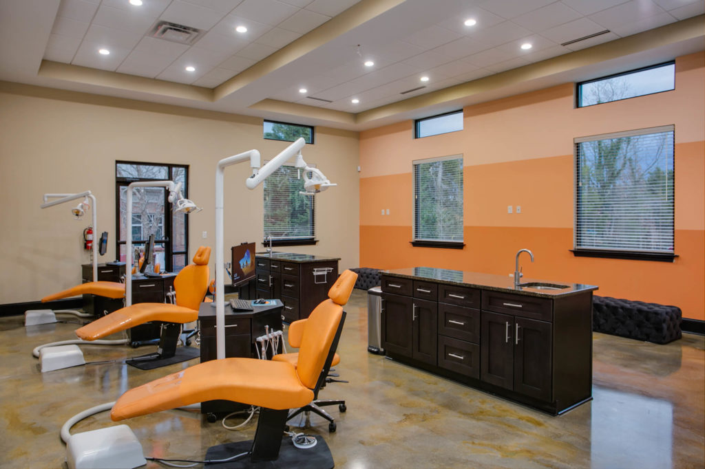 Winston Salem Orthodontist bay with Orange striped wall and orange chairs