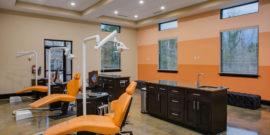 Winston Salem Orthodontist bay with Orange striped wall and orange chairs
