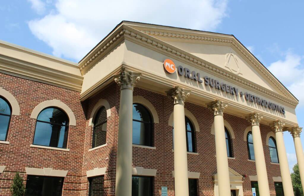 Cary NC orthodontic office two story brick building with cream colored columns