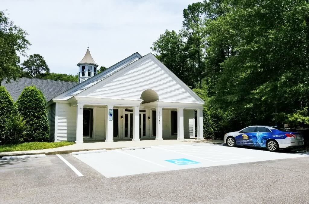 Exterior White Building with Columns at Southern Pines NC Oral Surgery + Orthodontics Location