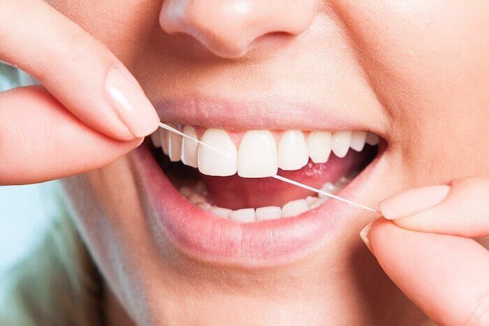 flossing-regulary-healthy-habit